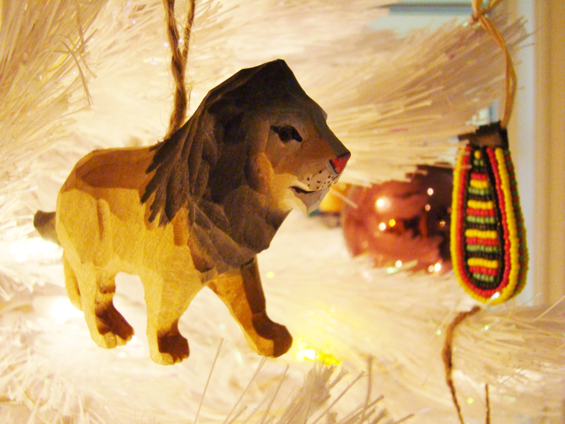 Fiorito Interior Design, interior design, Homes For The Holidays, African, holiday tree, carved wooden lion ornament, beaded ornament